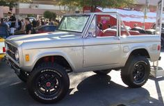 classic silver Ford Bronco top off