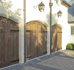 Real Carriage Doors is the leading manufacturer of wooden swinging doors and hardware. Browse our site today for outswing entry doors, garage doors, and more! Cheap Garage Doors, Garage Door Colors, Custom Garage Doors, Garage Door Lock, Garage Door Makeover, Garage Door Design, Custom Garages, Carriage House Garage Doors, Carriage Doors