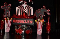 Circus carnival theme red and black candy topiary centerpiece for first birthday  www.sweeteventdesign.com