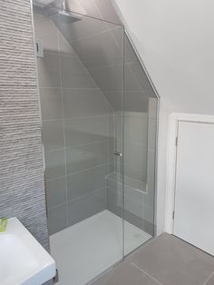 Frameless loft shower enclosure installed in Isleworth