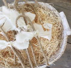 Jute covered candy canes with torn linen and button accent. Cute!