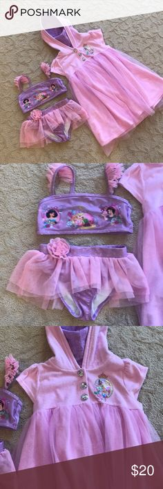 Bikini and Coverup Beautiful girls pink and purple bikini with matching hooded snap front coverup. Both are in very good condition may have a minor snag in tulle but won't even show in picks NO Holes!!!!! This came from the Disney Store. Bikini is a 5/6 and Coverup is a 7/8 my daughter wore both while in a size 6. Disney Swim Bikinis