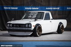 Starting with the pickup version of the Sunny, its owner, Dominic Le of Chasing Js, has created a 'Hakotora' through the use of a Hakosuka (C10 Skyline) front-end conversion from 09 Racing in Japan. The effect is dramatic, and that made this Datsun a real neck-snapper all week long at SEMA. As part of the 09 Racing conversion, some wild vented front fenders complete with dry …