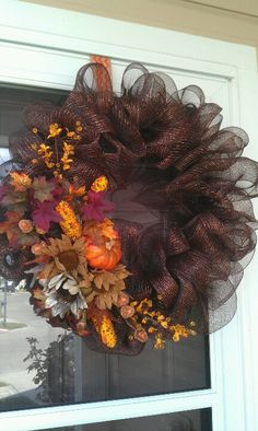 Fall wreath for the front door. Using the mesh then leave a gap to add foam to arrange flowers.