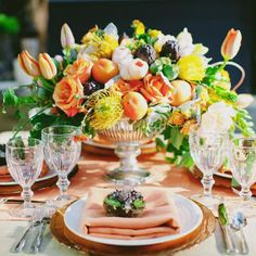 Love the use of fruits and protea in this bright centerpiece!