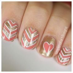We just love this clever gold and coral nail design. #nailart #nails #pinterest