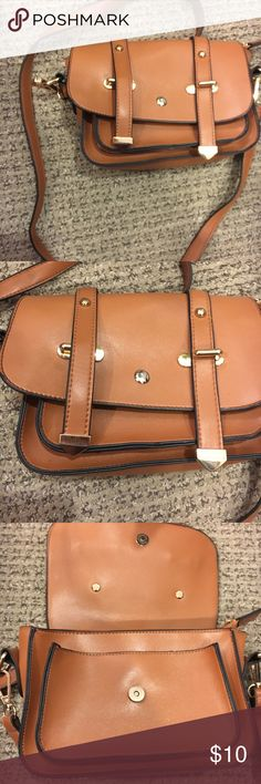 Small brown cross body satchel Light brown satchel. Purse strap is 20 inches in length. The strap can also be removed. The purse has two pockets on the inside. Gently used. Very cute for any occasion. Bags Satchels
