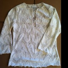 """Bright White Eyelet Stretch Top, Sz M Long sleeve, full stretch white V neck top. If your brave, wear it w/o a tank - or great as a swimsuit cover top. NWOT. Measures 16"""" across chest and 21"""" in length. Tagged as a Sz L, but I believe it fits closer to an M. Vol 1 Tops"""