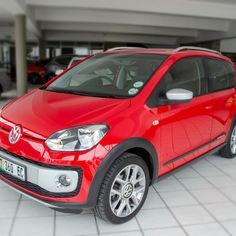 Isn't this the coolest city car your money can buy? The 2016 Volkswagen Cross Up! looks fantastic in red, too. Volkswagen Up, Vw Up, Vw Cross Up, One Drive, Roof Rails, City Car, Engine Types, Red Interiors, Entertainment System