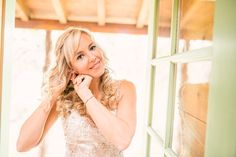 Gorgeous, natural light photo of a bride getting ready at her mountain wedding venue.