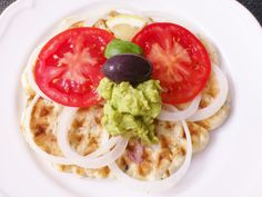Homemade zucchini & hummus waffle with avocado & tomatoes! #vegan #organic #glutenfree #hummus #avocado #waffle #food