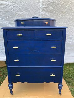 Don't be afraid to add a POP of color to your bedroom set.  This beautiful antique dresser was painted with General Finishes Klein Blue Milk Paint and topped with a Black Glaze.  The brass handles makes it user friendly and ready to roll into your home.