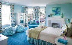 Girls Bedroom Interior In Blue Color Scheme With Single Size Bed And Double Bean Bag Chairs On Blue Pile Carpet