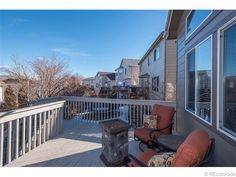 With a deck like this how could you not fall in love with this house - and the view of the city and mountains isn't a bad deal either! 9477  Burgundy Circle Littleton, CO, 80126