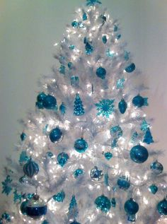 i love white christmas trees the best especially with blue ornaments like these