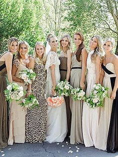 Non matching coordinating bridesmaids.  Love this.  Unified by staying neutral and all carrying the same flowers.