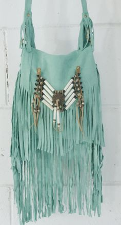 turquoise fringe. my favorite color and fringe! i want this...