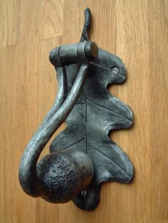 Blacksmith forged metalwork decorative, sculptural acorn door knocker,door furniture, Ironmongery made by Sussex Blacksmith James Price