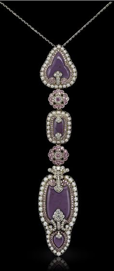 Faberge Scheherazade Long Pendant. This piece is set in 18 carat gold and silver and features 323 white and pink diamonds and white pearls totaling 9.92 carats.