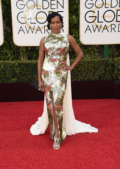 2016 Golden Globes Red Carpet - Regina King in a sleeveless, gold metallic gown with cape