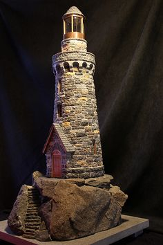 miniature stone lighthouses