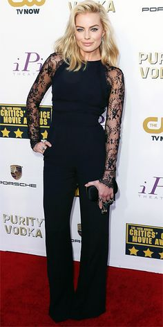 Margot Robbie wearing a black Elie Saab jumpsuit featuring lace sleeves, with an Alexander McQueen clutch and Ileana Makri jewelry.