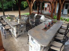 Gorgeous outdoor kitchen with bar seating created by Tulsa Patioscapes
