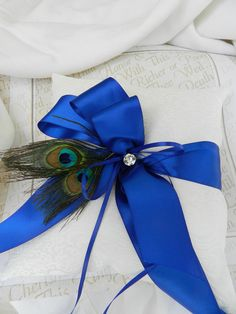 Royal Blue Ring Bearer Pillow in White and Peacock Feathers. $45.00, via Etsy.