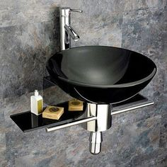Update your bathroom decor with this complete bathroom vanity set. This contemporary vanity features a black glass vessel sink and a chrome finished faucet. Set includes: Vanity, faucet and plumbing C Vessel Sink Vanity, Glass Vessel Sinks, Single Sink Bathroom Vanity, Sink Faucets, Bathroom Sinks, Single Vanities, Bathroom Black, Bathroom Ideas, Bath Vanities