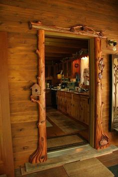 Beautifully rustic carved door frame for a cabin. Casa Dos Hobbits, Log Home Interiors, Cabin Doors, Log Cabin Homes, Log Cabins, Rustic Cabins, The Doors, Entry Doors, Cabins And Cottages