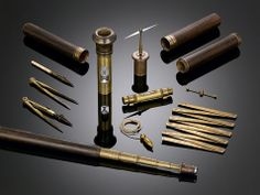 This walking stick is a portable laboratory, and places a variety of scientific instruments and experimental necessities within easy reach ~ M.S. Rau Antiques