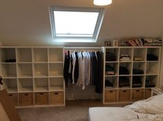 """Ikea Kallax clothes storage. """"His & Hers wardrobes"""". Open clothes storage. Baskets for undies and a rail in between (Ikea komplement)."""