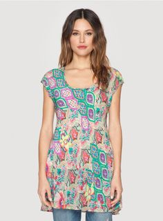 Tropical Scoopneck Tee Life's a beach in the Johnny Was TROPICAL SCOOP NECK TEE! This printed tunic top features a tropical-inspired patchwork print in cheerful hues. With a scoop neckline, short sleeves, and a flutter hemline, the TROPICAL SCOOP NECK TEE is both fun and flattering! Pair this tropical print tunic top with white linen pants and sandals for a day at the shore!