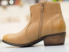 "These super cute faux-leather booties are must-haves. They come in natural, tan, and black. they have stitching details, inner zipper for easy on-and-off wear, and a small 2"" heel. Definitely a great addition to any shoe collection!This style has been running true to size"