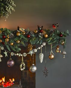 Drape a festive garland across your fireplace or intertwine along your stairs, to create a Christmas interior inspired by the Highlands. Decorate with festive robins and metallic baubles for the perfect finishing touch.