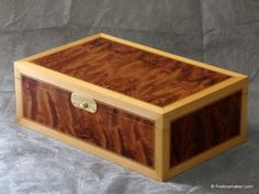 Traditionally styled jewellery/valet box. Subtle and interesting exterior with strongly contrasted interior, works well as a man's valet or as a lady's jewellery box Marbled rich red brown Kevazingo with multi-directional grain giving a 3 dimensional like quality and creamy Maple borders.