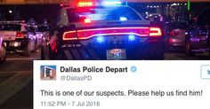 The man appeared to be carrying a rifle while marching peacefully in Dallas.