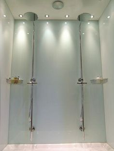 Photograph of shower area fitted with an Opticolour mint white back shower wall panel andOpticolour white side shower wall panels