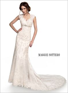Bernadette -- Slim line gown with button over zipper closure. This intricate lace gown features a beautiful high mandarin keyhole back and a fishtail train finished with scalloped edging. Swarovski crystals are delicately sprinkled throughout with rich decorative beading at the empire waist.