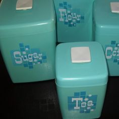 retro turquoise kitchen canisters. So cute! Just bought some retro canisters though.