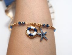 Gold Navy Starfish & Ring Buoy Bracelet by VespertineCosmos £18 #nauticaljewelry #navyjewelry #beachjewelry #jewelrygift