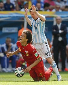 Argentina's Lionel Messi, right, fouls Belgium's Axel Witsel during the World Cup quarterfinal soccer match between Argentina and Belgium at the Estadio Nacional in Brasilia, Brazil, Saturday, July 5, 2014.