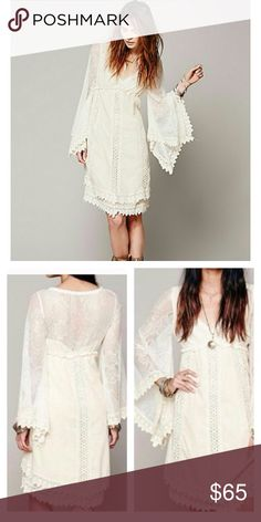 """Free People Nightingale Dress size XS Gorgeous bohemian lace dress in cream.  Bell sleeves. Skirt portion is fully lined. Sleeves and upper back are sheer. Only worn 3 to 4 times. Approx 40"""" length Free People Dresses Midi"""
