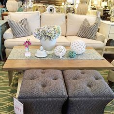 We love everything about this: the textured ottomans, the ceramic accents, those wonderful pillows. Perfection!  {Down to Earth} #interiors #gardnervillage #downtoearthhome #furniture #interiordesign