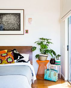 Master Bedroom.  Artworks above bed – 'Nest' by Jacinta Patterson, 'Love Life' print by Letitia, and and small artwork by MSG.  Photo - Sean Fennessy, production – Lucy Feagins / The Design Files.