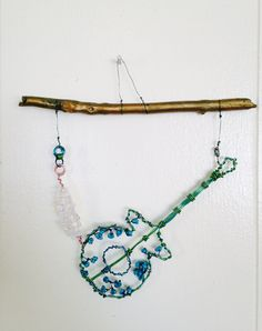 """""""Don't Fret so much""""  guitar  Mixed media wire beads   Marna McManus   On Facebook @sunshowercreations Dream Catcher, Mixed Media, Guitar, Wire, Facebook, Beads, Decor, Beading, Dreamcatchers"""