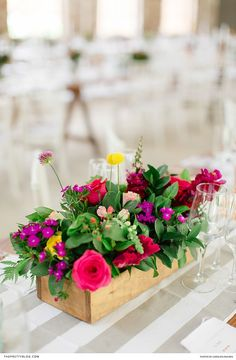 Arranging brightly-coloured flowers in wooden boxes will add a dose of rustic flair to your décor and bring about a joyous atmosphere. | Photographer: Carolien and Ben | Florist: Pebble & Lace