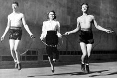 """Dan Dailey, Jean Rogers and William Lundigan skip rope on the set of """"Sunday Punch"""" (1942)"""