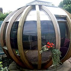 In my dream house I will have room for a futuristic summer house, such as this.  Because, of course, money will be no object whatsoever.