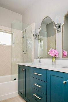 Wonderfully appointed bathroom boasts a peacock blue dual washstand donning polished nickel pulls and a white quartz countertop. Bathroom Countertops, Bathroom Flooring, Quartz Countertops, Ceramic Tile Floor Bathroom, Hamptons Style Homes, Hamptons House, Small Bathroom Colors, Blue Vanity, Visual Comfort Lighting